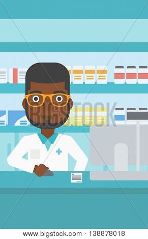 An african-american young pharmacist in medical gown standing at pharmacy counter and working on a computer. Vector flat design illustration. Vertical layout.