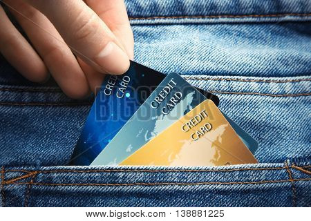 Female hand putting credit card in pocket