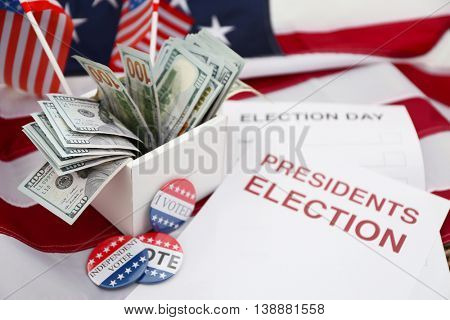 American vote concept. Ballot for presidents election 2016 and many dollar banknotes on stars and stripes background
