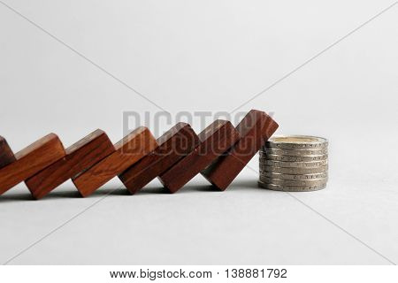 Dominoes and coins on grey background