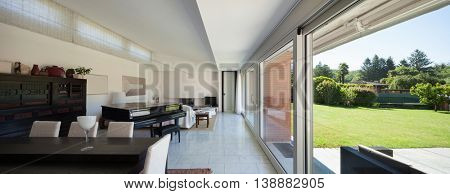 Lounge of a modern house, big windows, interior