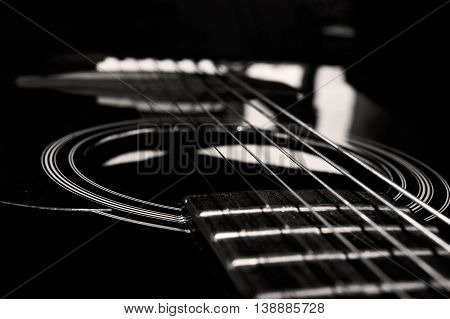A close look at the strings of an acoustic guitar.