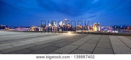 cityscape and skyline of chongqing at twilight on view from empty floor