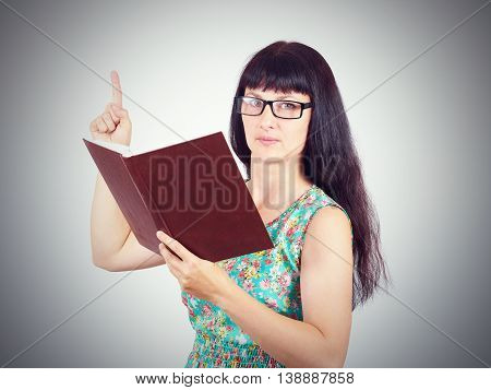 The Teacher With Glasses Holding A Book In His Hands. Showing Thumbs Up.