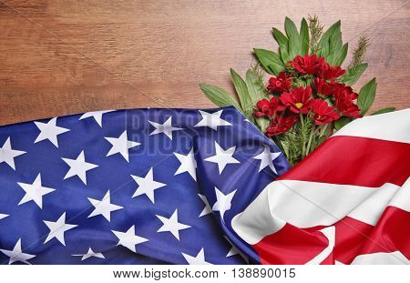 Flowers and American flag on a wooden background