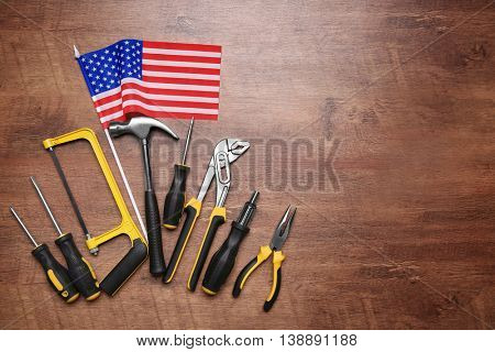 Tools on a wooden background. Labor day concept