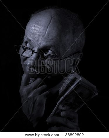 Sly Senior Man Holding Dollar Bills