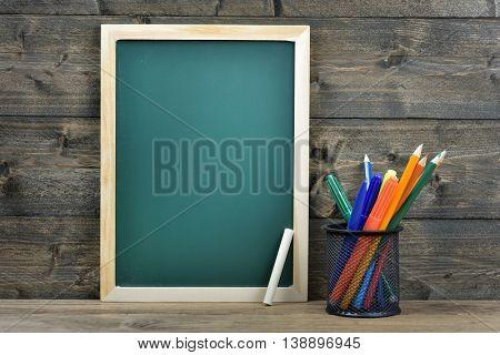 School board on wooden table