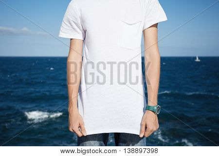 Cropped Shot Of Young Caucasian Man Wearing Jeans And Blank White T-shirt With Copy Space For Your P