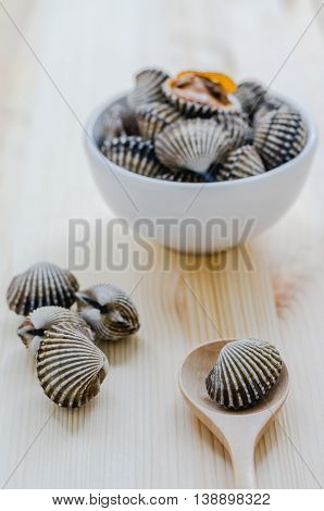 Steamed Blanched Clams In White Bowl On Wooden Background