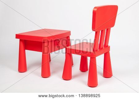 red chair and red table for children in kindergarten preschool classroom