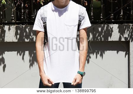 Cropped Portrait Of Teenage Boy Wearing White Blank T-shirt With Copy Space For Your Text Or Adverti