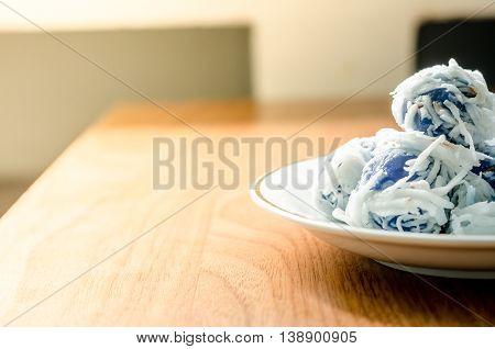 Thai Dessert Coconut Munchkins In White Dish On Wooden Background