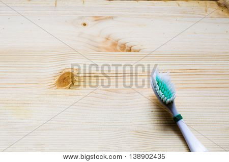 Old Toothbrush On Wooden Background. Cinematic Tone