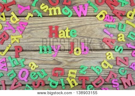 Hate my job word on wooden table