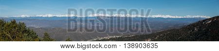 Big panorama of the Pyrenees mountains with snow at top of the range