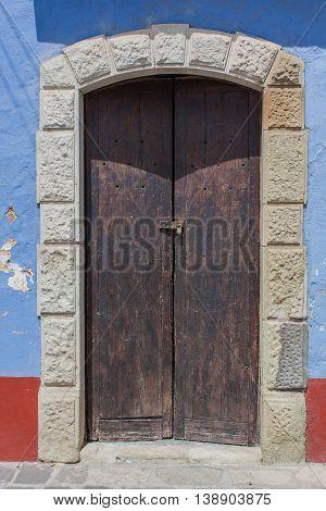 Old Brown Door wooden in rural house blue