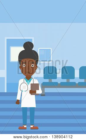 An african-american young female friendly doctor with stetoscope standing in hospital corridor and carrying folder of patient or medical information. Vector flat design illustration. Vertical layout.