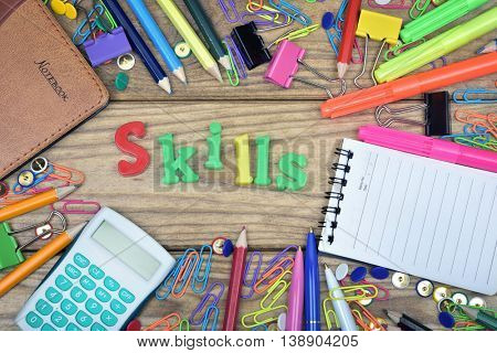Skills word and office tools on wooden table