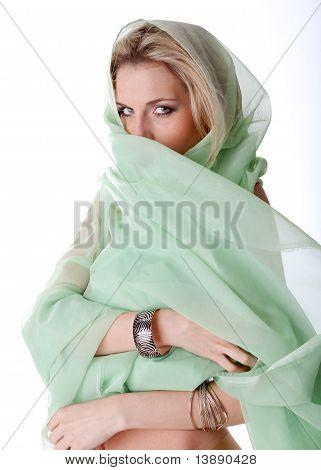 Beautiful woman in green veil
