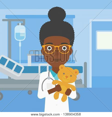 An african-american female pediatrician doctor holding a teddy bear on the background of hospital room. Vector flat design illustration. Square layout.