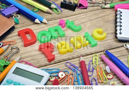 Don't panic word and office tools on wooden table