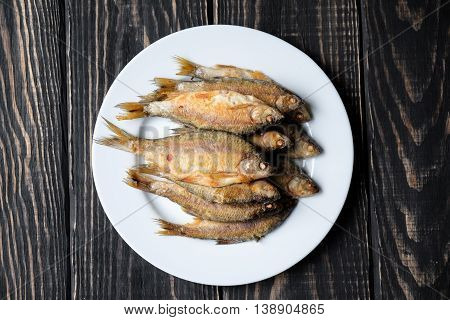 Fried Fish On A White Plate