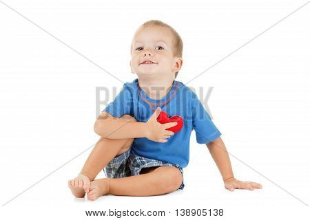 Little caucasian child with a heart symbol isolated on white. Concept of love, tenderness and health.