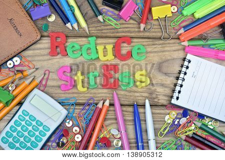 Reduce Stress text and office tools on wooden table
