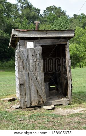 Old wooden outhouse at rural Georgia, USA.