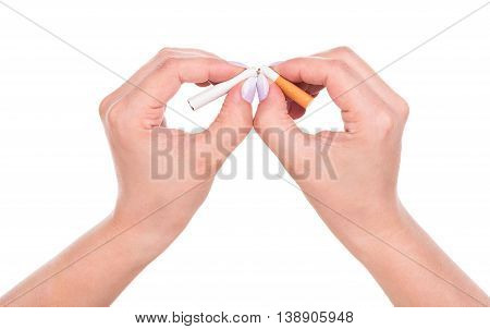 Young female hands with cigarette isolated over white background