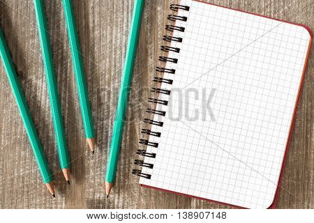 Spiral notebook and four pencil.Copy-space for your text.