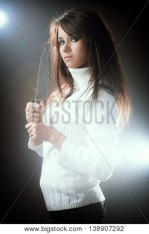 portrait of beauty woman pull out her Knife. ready to attack