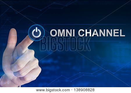double exposure business hand clicking omni channel button with blurred background