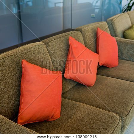 Pillows on the brown sofa in hotel