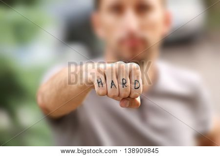 Man fist with fake tattoo