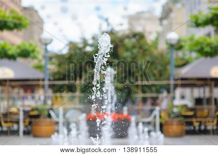 Splashes of water in city fountain. Gush of water of a fountain. Figure from the water fountain. Jet of water in city fountain.