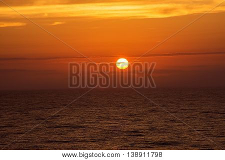 The sun goes down over the North Atlantic as seen from a cruise ship.
