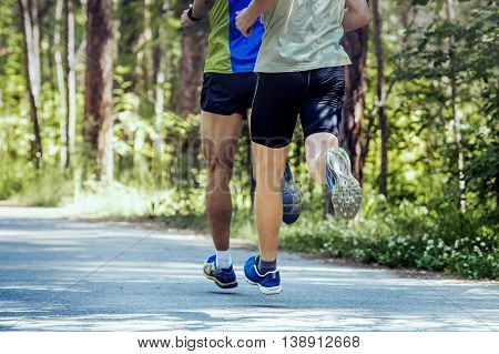two young athlete running down road in Park during marathon