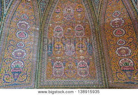 Ancient tiles with Persian patterns inside the mosque Nasir ol Molk, Isfahan. Traditional artworks made in 1888 in Iran