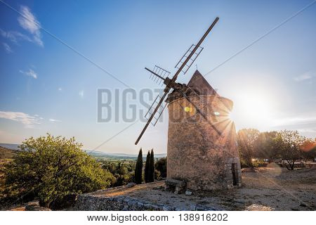 Old Stone Windmill Against Sunset In Saint Saturnin Les Apt, Provence, France