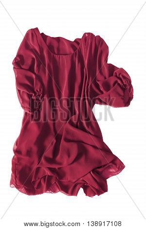 Red silk dress folded on white background