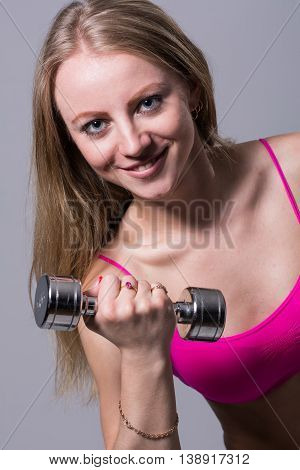 Close-up Portrait Of A Beautiful Girl With Dumbbell