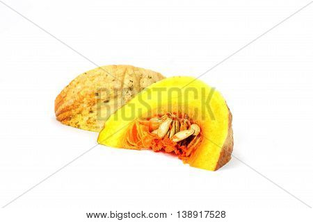 Small piece of yellow asian pumpkin on white background. Object side view.