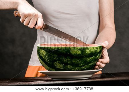 Woman Carving Watermelon