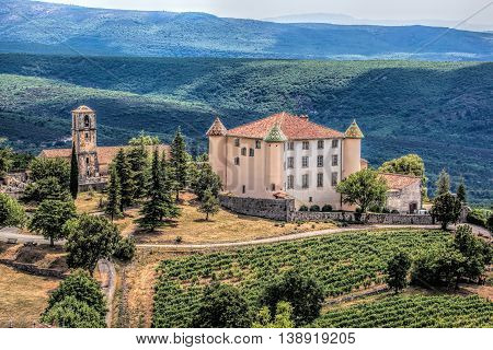 View Of Aiguines Village And Renaissance-style Chateau With Mountains In Provence, France