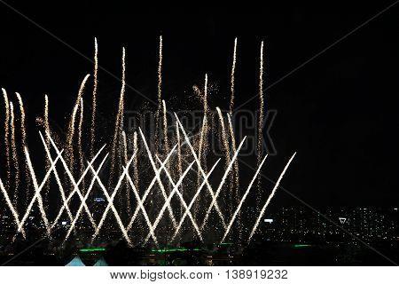 Beautiful fireworks on the city. International Fireworks. Fireworks display on dark sky background.