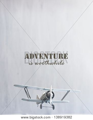Adventure is worthwhile. Inscription and retro plane.