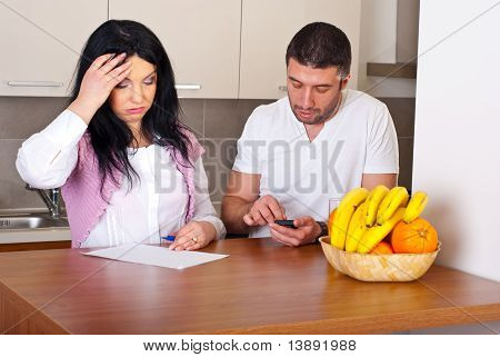 Couple Having Difficult To Calculate Expenses