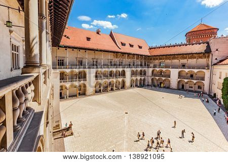 CRACOW, POLAND - June 30, 2016: Wawel Castle, Cracow, Poland. The tiered arcades of renaissance courtyard.
